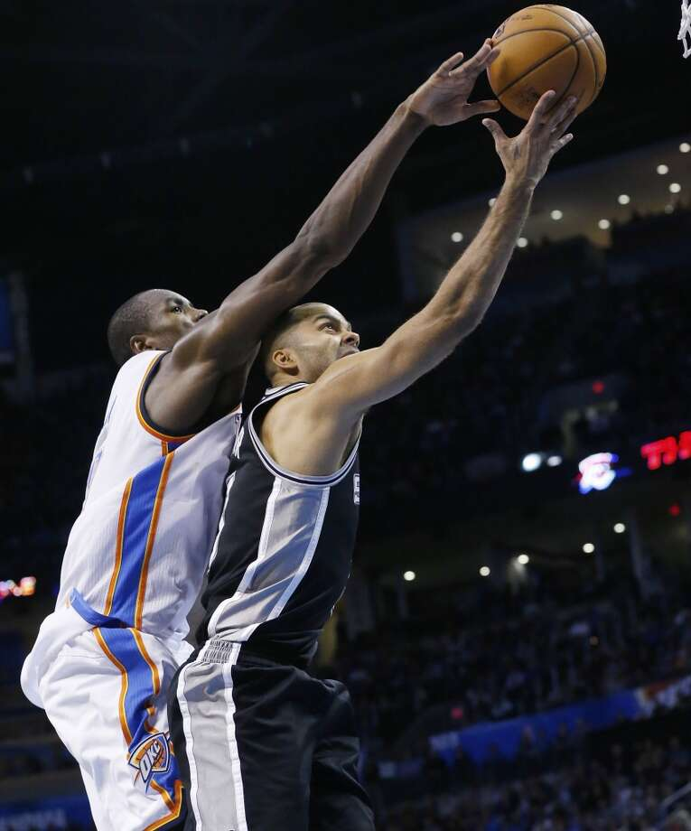 Oklahoma City Thunder forward Serge Ibaka (9) blocks a shot by San Antonio Spurs guard Tony Parker (9) in the fourth quarter of an NBA basketball game in Oklahoma City, Wednesday, Nov. 27, 2013. Oklahoma City won 94-88. (AP Photo/Sue Ogrocki) Photo: Associated Press