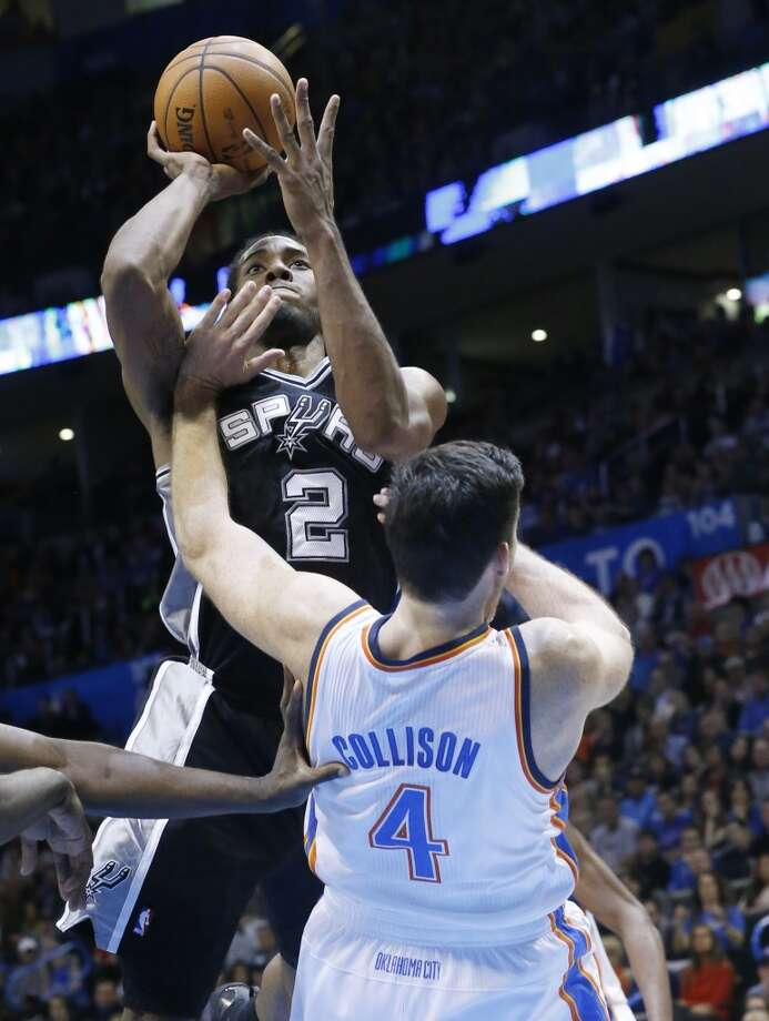 San Antonio Spurs forward Kawhi Leonard (2) fouls Oklahoma City Thunder forward Nick Collison (4) as he shoots in the third quarter of an NBA basketball game in Oklahoma City, Wednesday, Nov. 27, 2013. Oklahoma City won 94-88. (AP Photo/Sue Ogrocki) Photo: Associated Press