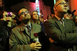 San Francisco Board of Supervisors' David Campos, left, listens to speeches about tenant rights next to Rafael Mandelman, right, during the 35th annual Harvey Milk/George Moscone Memorial Vigil and March November 27, 2013 in the Harvey Milk Plaza in the Castro District in San Francisco, Calif. The annual event highlights the 35th anniversary of their deaths at city hall. This year, the organizers used the event as a platform to speak out against San Francisco's skyrocketing rent prices, something that has led to thousands of evictions in recent years.