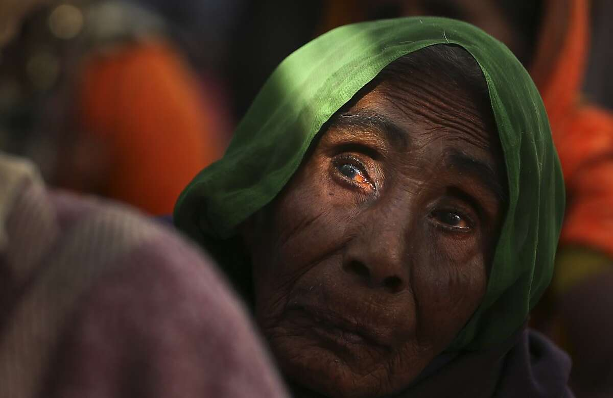 An elderly woman participates in a protest in New Delhi, India, Wednesday, Nov. 27, 2013. The protesters demanded a universal old age pension for those above 60 years of age, opposing the central government's proposal of US $3 per month. India is home to 142.9 million elderly above the age of 54. (AP Photo/Manish Swarup)