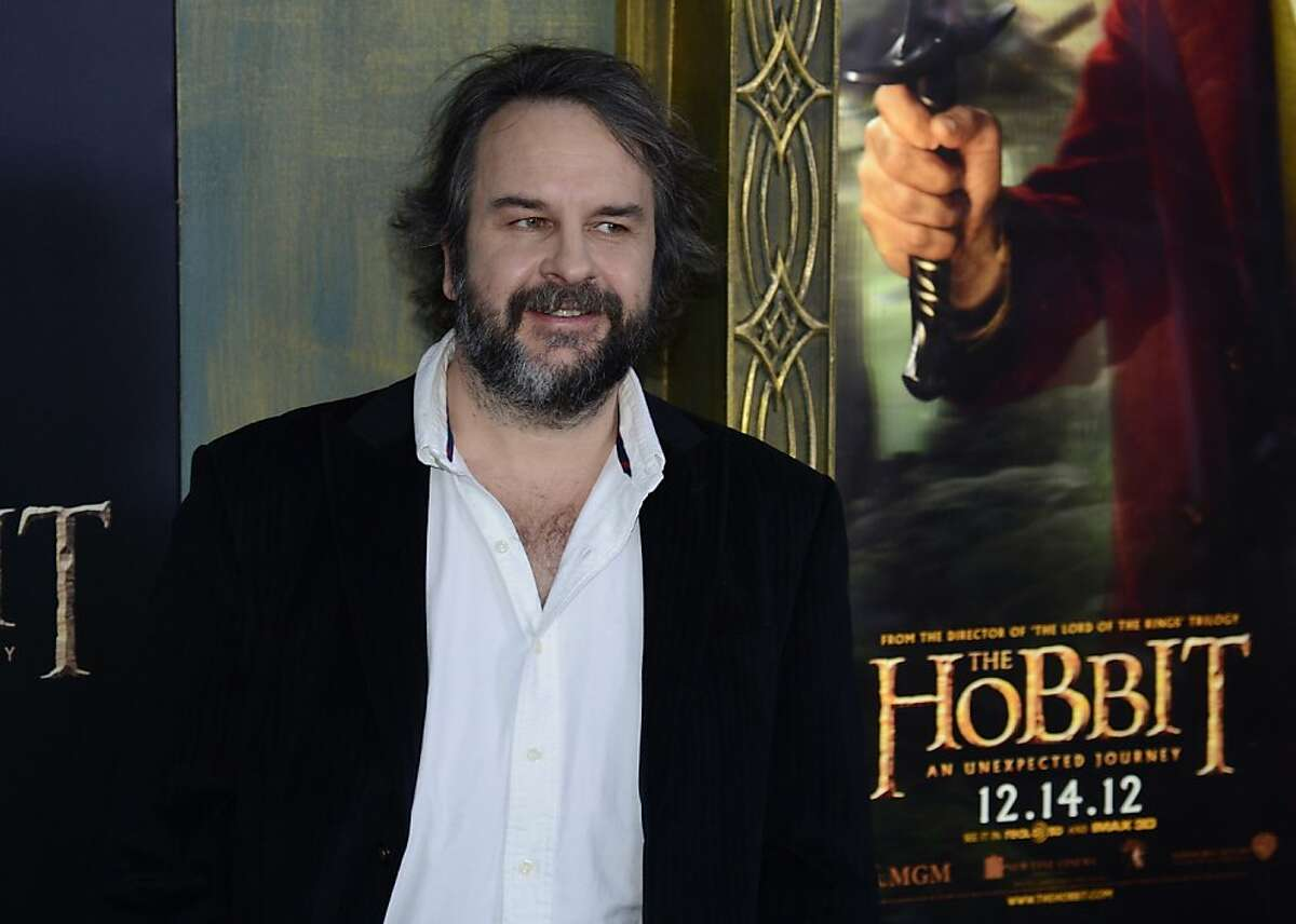 """(FILES)New Zealand director Peter Jackson arrives at the US premiere of """"The Hobbit: An Unexpected Journey"""" in this December 6, 2012 file photo at the Ziegfeld Theatre in New York. A rights group that monitors animals used in the entertainment industry has dismissed a report that it turns a blind eye to deaths and injuries because it is too cozy with TV and film bosses. The Hollywood Reporter lists alleged incidents on movies including Ang Lee's Oscar-winning """"Life of Pi,"""" the """"Pirates of the Caribbean"""" blockbusters and """"The Hobbit: an Unexpected Journey,"""" among others. Twenty-seven animals involved in the production of the first of Peter Jackson's """"Hobbit"""" trilogy died, it said, also listing other incidents in which a chipmunk was squashed, a husky dog was punched, and fish died. But the American Humane Association (AHA) said the story """"distorts the work and record of a respected nonprofit organization that has kept millions of beloved animal actors safe on film and television sets around the world."""" AFP PHOTO/Stan HONDASTAN HONDA/AFP/Getty Images"""