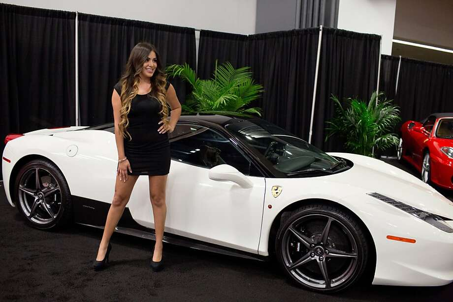 Adriana Salas poses in front of a Ferrari 458 Italia at the VIP showing of the 56th Annual Auto Show at The Moscone Center in San Francisco, Calif., Wednesday, November 27, 2013. Photo: Jason Henry, Special To The Chronicle