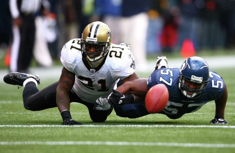 Seahawks player David Hawthorne knocks the ball away from New Orleans Saints player Julius Jones in the first half of an NFL playoff wildcard game Jan. 8, 2011, in Seattle. Photo: Joshua Trujillo, Joshua Trujillo/seattlepi.com / Seattlepi.com
