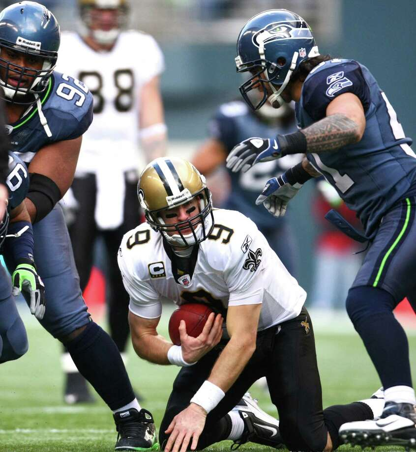 Saints quarterback Drew Brees looks up after being sacked  by the Seahawks in the first half of an NFL playoff wildcard game Jan. 8, 2011,  in Seattle. Photo: Joshua Trujillo, Joshua Trujillo/seattlepi.com / Seattlepi.com