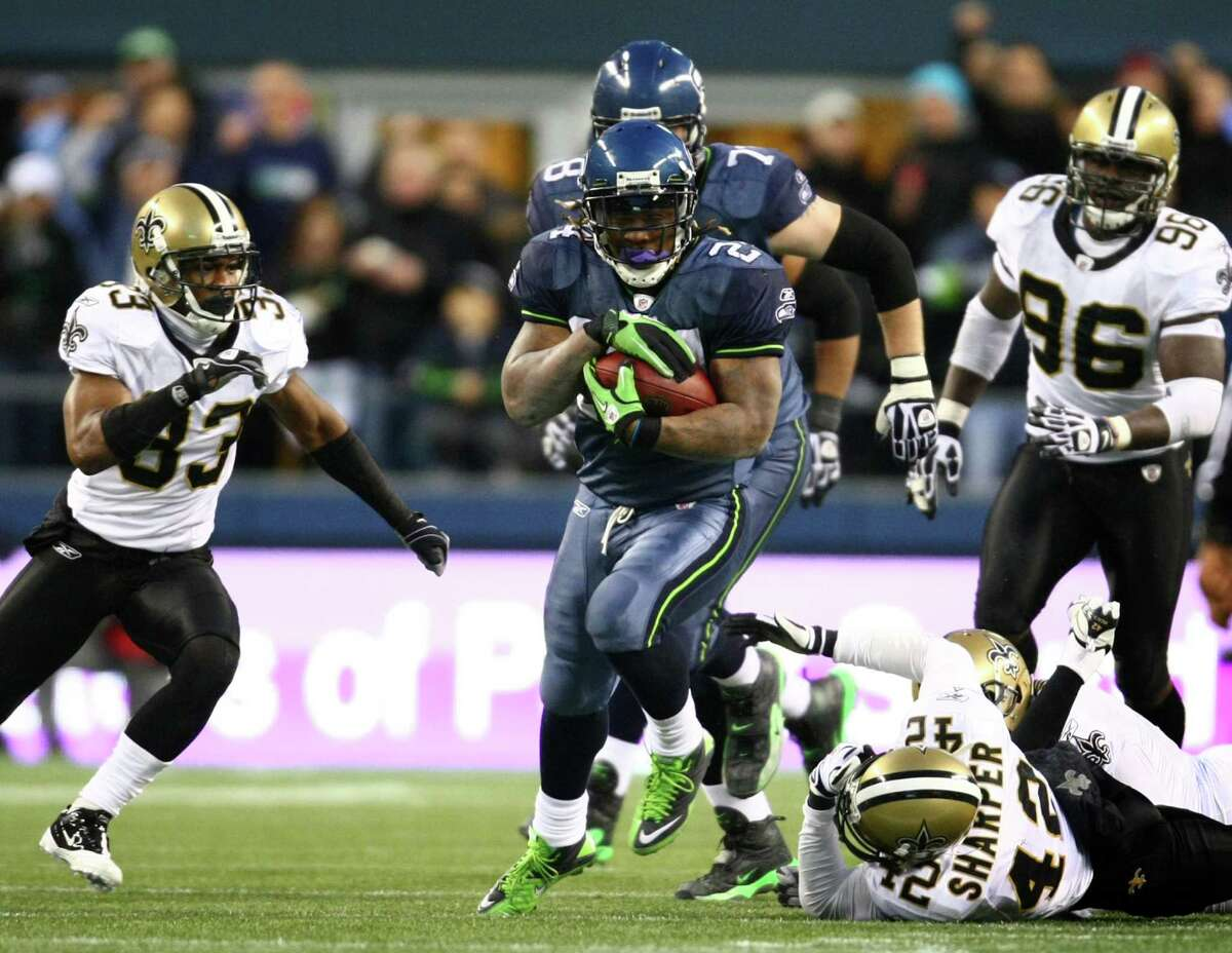 Seahawks running back Marshawn Lynch breaks through New Orleans defenders during a 67-yard touchdown run in the fourth quarter against the defending Super Bowl champs during an NFL playoff wildcard game Jan. 8, 2011, in Seattle. The Hawks defeated the Saints 41-36.