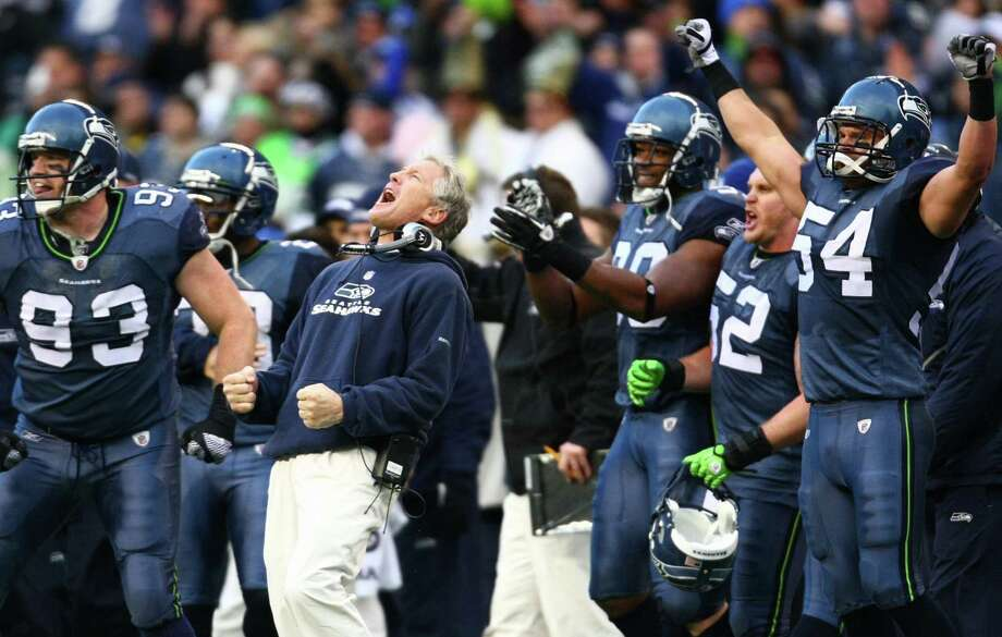 Seahawks head coach Pete Carroll and the bench erupt after the Hawks stopped the New Orleans Saints on a fourth-down play in the second half of a NFL playoff wildcard game Jan. 8, 2011, in Seattle. Photo: Joshua Trujillo, Joshua Trujillo/seattlepi.com / Seattlepi.com