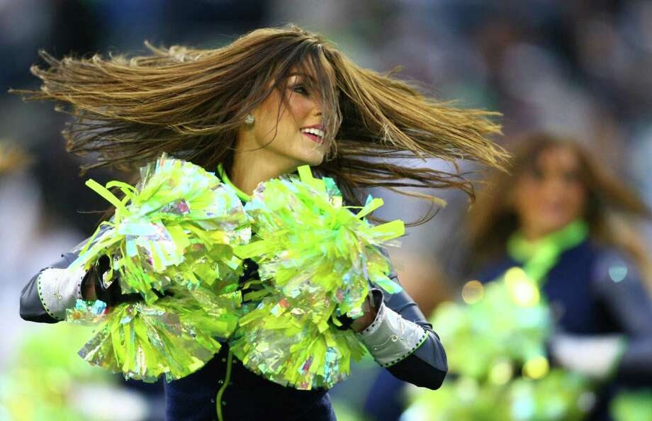 A Seahawks cheerleader spins while performing a routine during an NFL playoff wildcard game Jan. 8, 2011, against the New Orleans Saints  in Seattle. Photo: Joshua Trujillo, Joshua Trujillo/seattlepi.com / Seattlepi.com