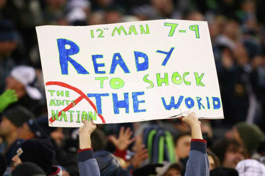 A Seahawks fan holds up a sign during an NFL playoff wildcard game against the defending Super 