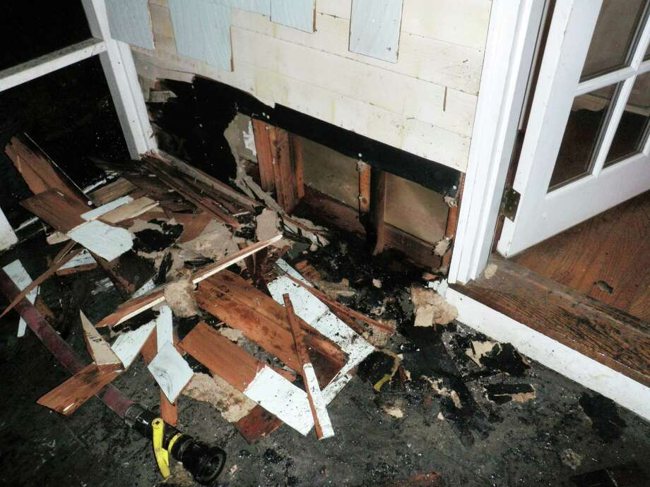 The remains of a porch fire at a Sachem Trail home that ignited Wednesday night from the improper disposal of smoldering fireplace ashes. Photo: Westport Fire Department / Westport News contributed