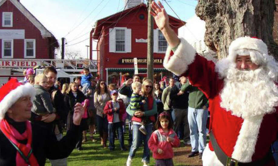 A large crowd is expected Saturday at Sherman Green, as in years past, to greet Santa Claus, who will arrive by fire truck to kick off the town's holiday season. Photo: File Photo / Fairfield Citizen