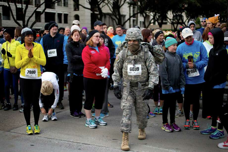 Ismael Guerrero, 21, of the U.S Army stretches before running the 2013 TXU Energy Turkey Trot, Thursday, Nov. 28, 2013, in Houston. This year is Guerrero's fourth year running the race. Photo: Marie D. De Jesus, Houston Chronicle / © 2013 Houston Chronicle