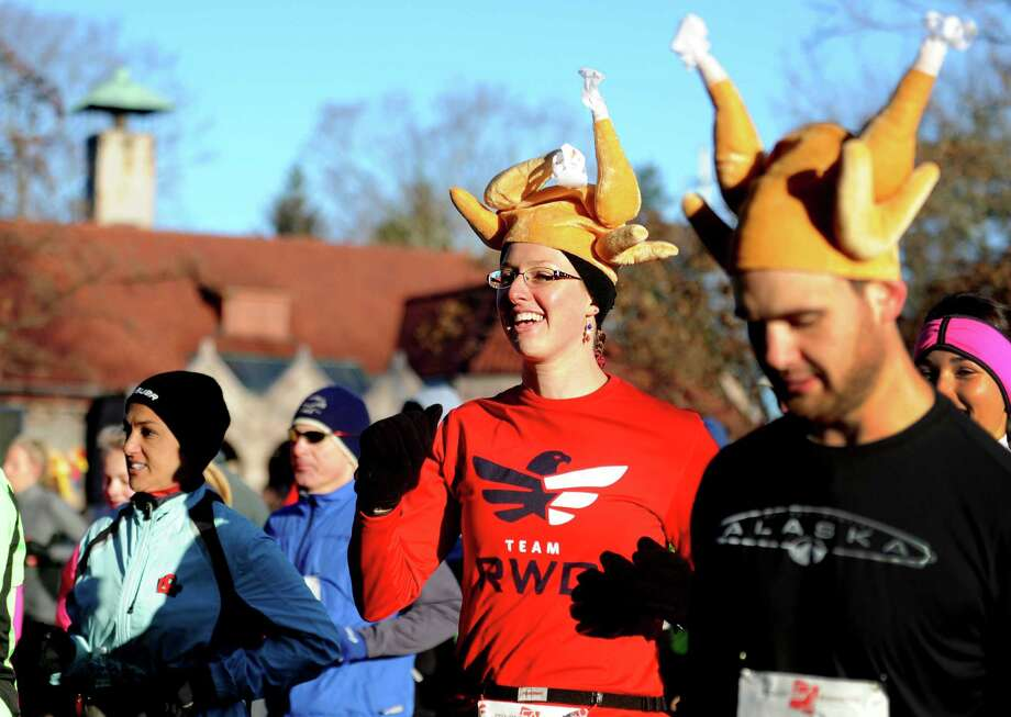 Laura Henry, of Baldwinsville, NY, wears her turkey hat as she runs in the annual Pequot Road Runners Thanksgiving Day 5 Mile Road Race Thursday, Nov. 28, 2013 in Southport, Conn. Photo: Autumn Driscoll / Connecticut Post