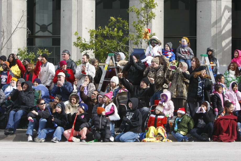 Spectators watch the Thanksgiving parade along Walker Street.   Photo: Cody Duty, Houston Chronicle