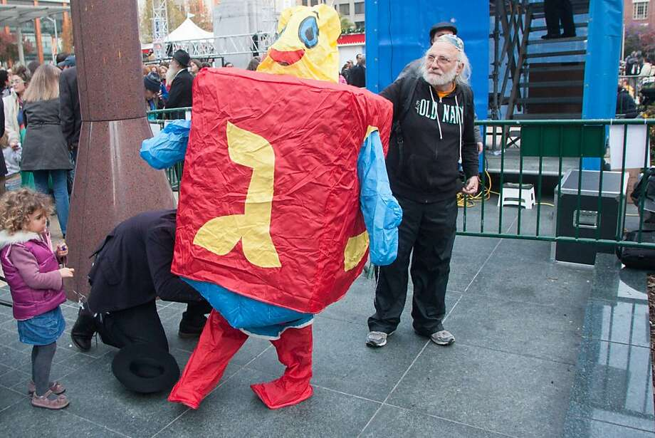 "Mo Sasdie is dressed up as a ""human dradle"" as people gather for the 39th annual lighting of the Bill Graham Menorah in Union Square on Nov. 27, 2013. There have been lighting ceremony celebrating Hanukkah in Union Square since 1975. Photo: Douglas Zimmerman"