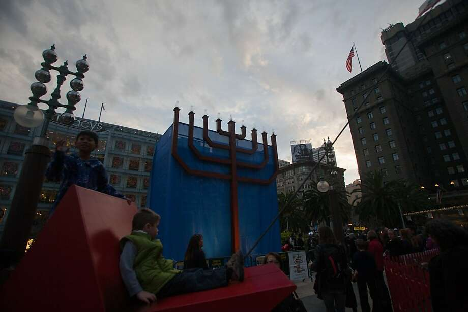 People gather for the 39th annual lighting of the Bill Graham Menorah in Union Square on Nov. 27, 2013.  Hosted by Rabbi Yosef Langer and Chabad of San Francisco, there have been lighting ceremony celebrating Hanukkah in Union Square since 1975.  The Menorah was the first outdoor public lighting ceremony celebrated outside of Israel.  Rabbi Langer was assisted by Andy David, the Israeli Consul General  and Lori Starr, the Executive Director of The Jewish Contemporary Museum. Photo: Douglas Zimmerman