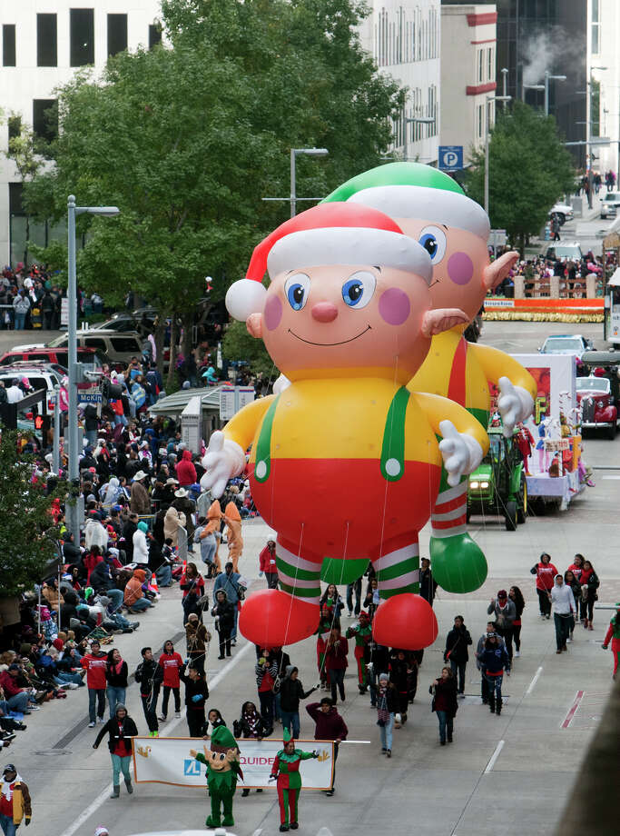 Spectators watch as elves are pulled South along Milam Street during the 64th annual Thanksgiving Day Parade, Thursday, Nov. 28, 2013, in Houston. Photo: Cody Duty, Houston Chronicle / © 2013 Houston Chronicle