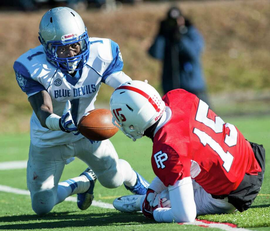 West Haven high school's Ervin Philips tries to grab a loose ball that was a pass intended for Fairfield Prep's John DelliSanti that he broke up during a Thanksgiving Day football game played at Alumni field, Fairfield University, Fairfield, CT on Thursday, November 28th, 2013. Philips was unable to control the ball and the pass was called incomplete. Photo: Mark Conrad / Connecticut Post Freelance