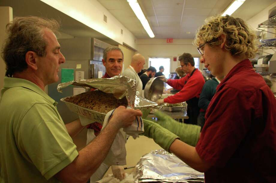 The kitchen was a beehive of activity as volunteers prepared meals for the Thanksgiving Community Feast, organized for hundreds of holiday diners Thursday by Saugatuck Congregational Church in the hall of Christ & Holy Trinity Episcopal Church. Photo: Jarret Liotta / Westport News contributed