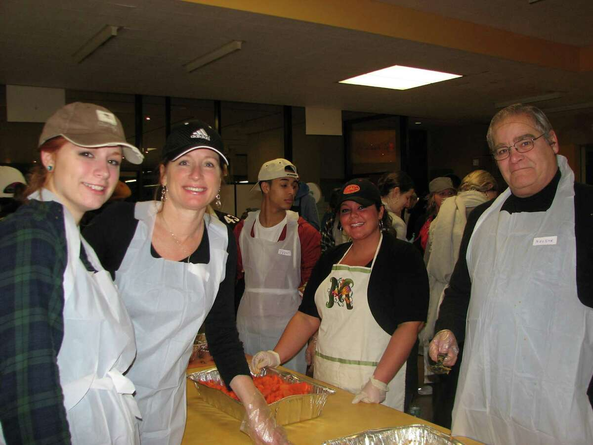 2. Make even more connections by volunteering. Getting involved with a charity during the holiday season could put you in contact with some pillars of the community. See who helped out at the annual Equinox Thanksgiving Day Community Dinner at the Empire State Plaza in Albany this year.