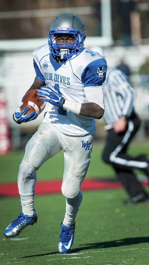 West Haven high school's Ervin Philips on his way to scoring a touchdown during a Thanksgiving Day football game against Fairfield Prep played at Alumni field, Fairfield University, Fairfield, CT on Thursday, November 28th, 2013. Photo: Mark Conrad / Connecticut Post Freelance