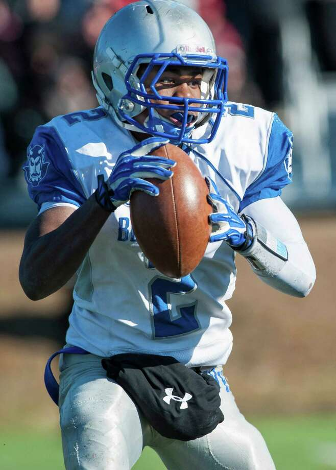 West Haven high school quarterback Duane Gary runs with the ball during a Thanksgiving Day football game against Fairfield Prep played at Alumni field, Fairfield University, Fairfield, CT on Thursday, November 28th, 2013. Photo: Mark Conrad / Connecticut Post Freelance
