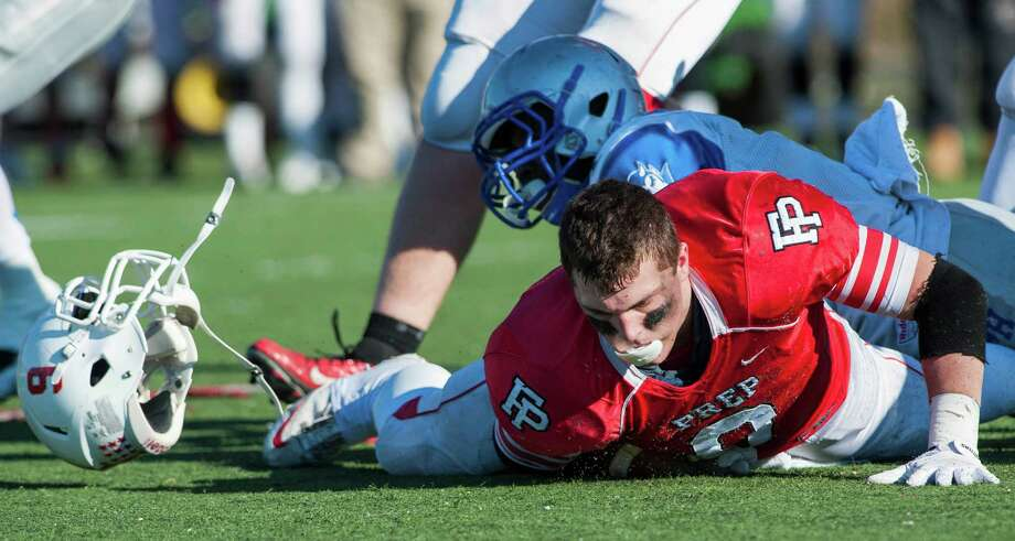 Fairfield Prep's Nicholas Crowle rushes for some yardage but loses his helmet during a Thanksgiving Day football game against West Haven high school played at Alumni field, Fairfield University, Fairfield, CT on Thursday, November 28th, 2013. Photo: Mark Conrad / Connecticut Post Freelance