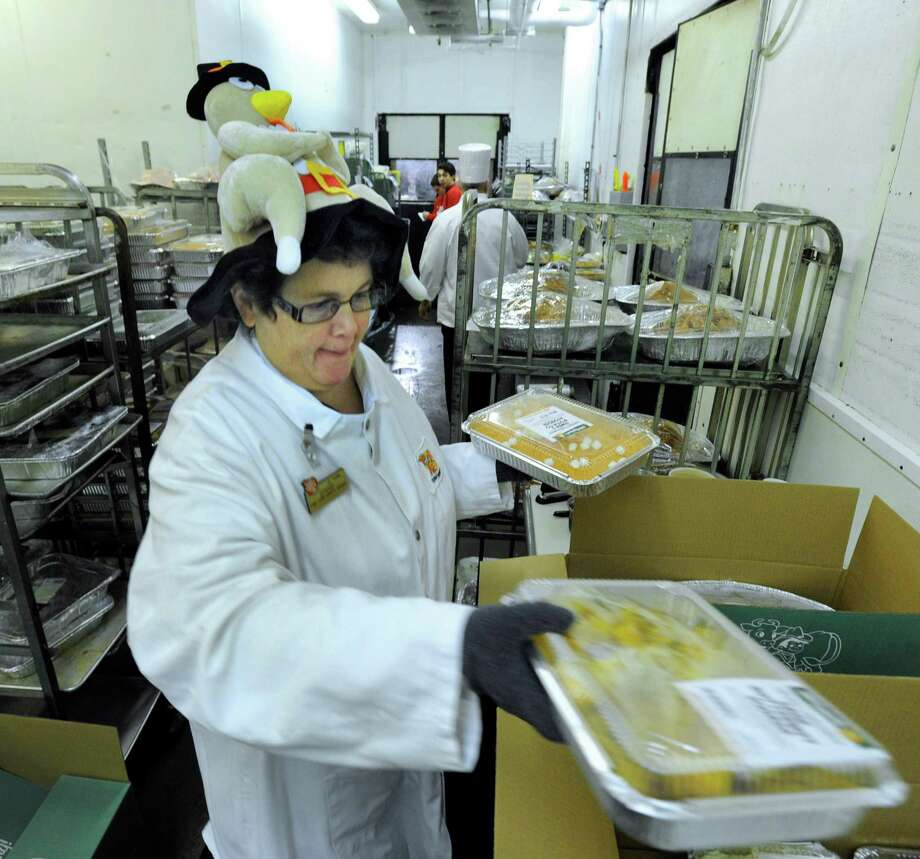 Barbara Bucknam,  50, of Danbury, packs boxes with Thanksgiving dinners for custoers at Stew Leonard's in Danbury, Conn., Thanksgiving morning, Nov. 28, 2013. Photo: Carol Kaliff / The News-Times