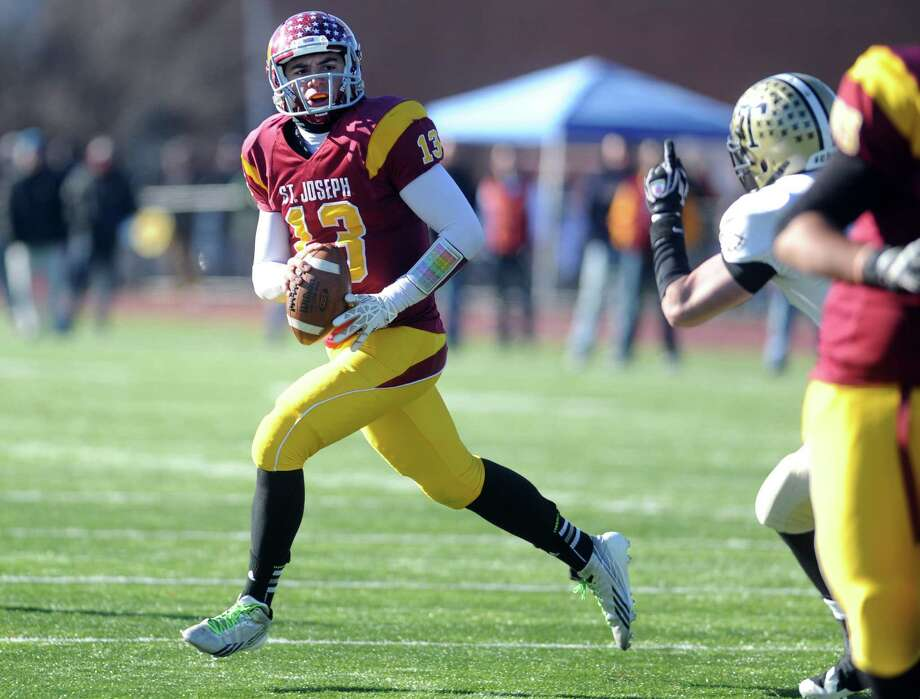 St. Joseph's Jordan Vazzano looks to pass the ball during the annual Thanksgiving Day football game against Trumbull Thursday, Nov. 28, 2013 at St. Joseph High School in Trumbull, Conn. Photo: Autumn Driscoll / Connecticut Post
