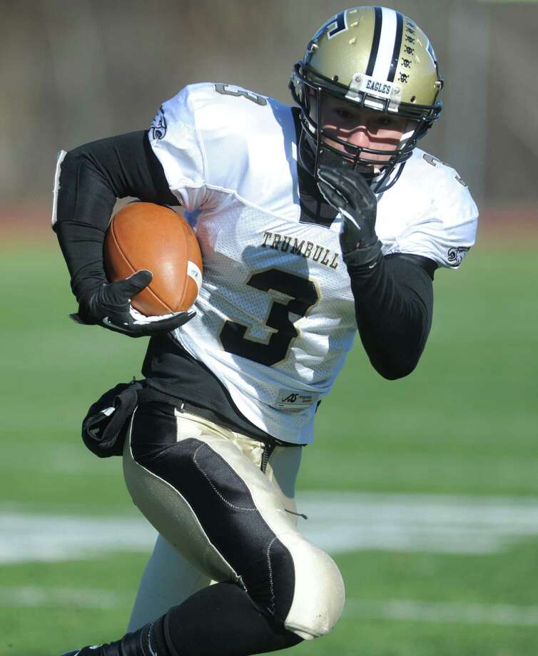 Trumbull's Hunter Wnukowski carries the ball during the annual Thanksgiving Day football game against St. Joseph Thursday, Nov. 28, 2013 at St. Joseph High School in Trumbull, Conn. Photo: Autumn Driscoll / Connecticut Post