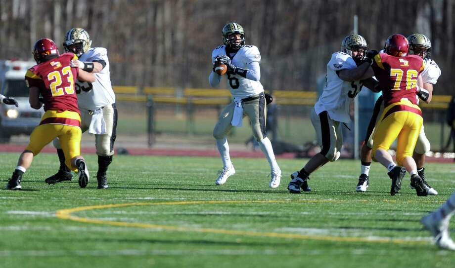 Trumbull's Jeff Sam looks to pass the ball during the annual Thanksgiving Day football game against St. Joseph Thursday, Nov. 28, 2013 at St. Joseph High School in Trumbull, Conn. Photo: Autumn Driscoll / Connecticut Post