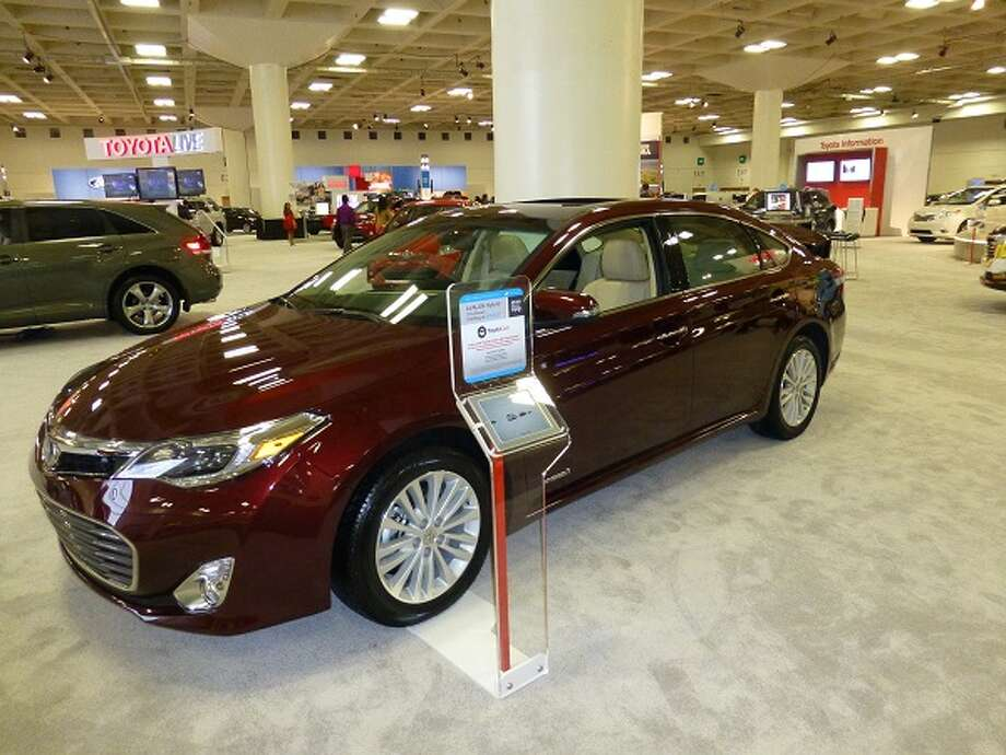 Toyota Avalon hybrid. Starts at about $34,000. Gets 40/39 mpg, city/highway. It won't break your pocketbook, but performs much like a more expensive Lexus.  (All photos by Michael Taylor)