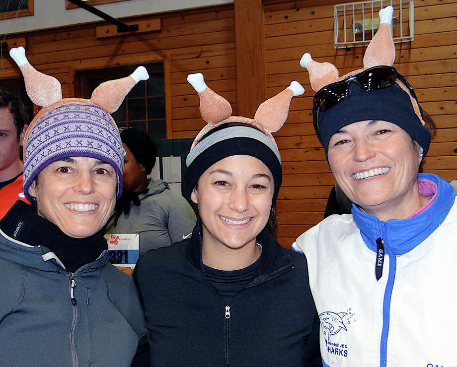 Jeanne and Natalie Capasse of Fairfield with Callie Schnog of West Hartford sport drumstick headwear Thursday at the 36th annual Pequot Runners Thanksgiving Day Race. Photo: Mike Lauterborn / Fairfield Citizen contributed