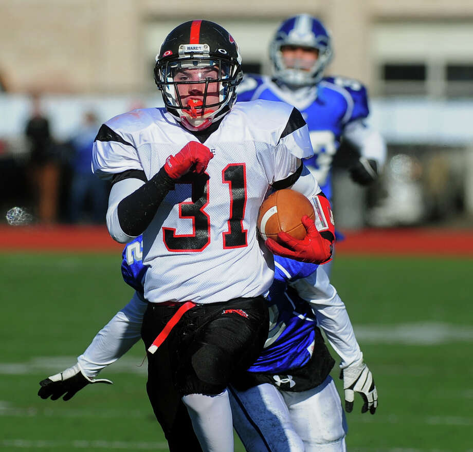 Fairfield Warde's T.J. Gallagher carries the ball 75 yards for a touchdown, during Thanksgivig Day football action against cross-town rival Fairfield Ludlowe in Fairfield, Conn. on Thursday November 28, 2013. Photo: Christian Abraham / Connecticut Post
