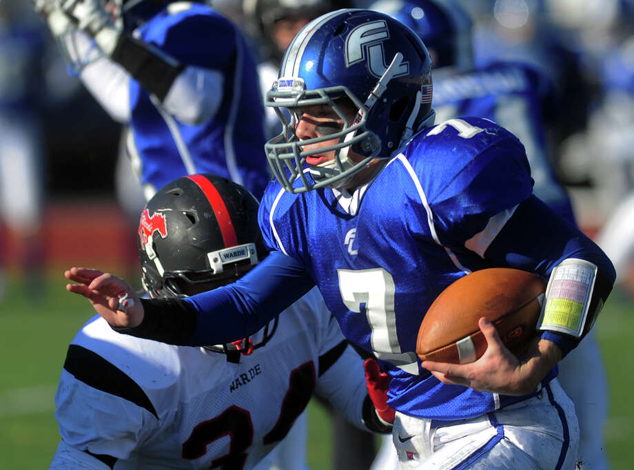 Fairfield Ludlowe QB Matt White carries the ball, during Thanksgivig Day football action against cross-town rival Fairfield Warde in Fairfield, Conn. on Thursday November 28, 2013. Photo: Christian Abraham / Connecticut Post