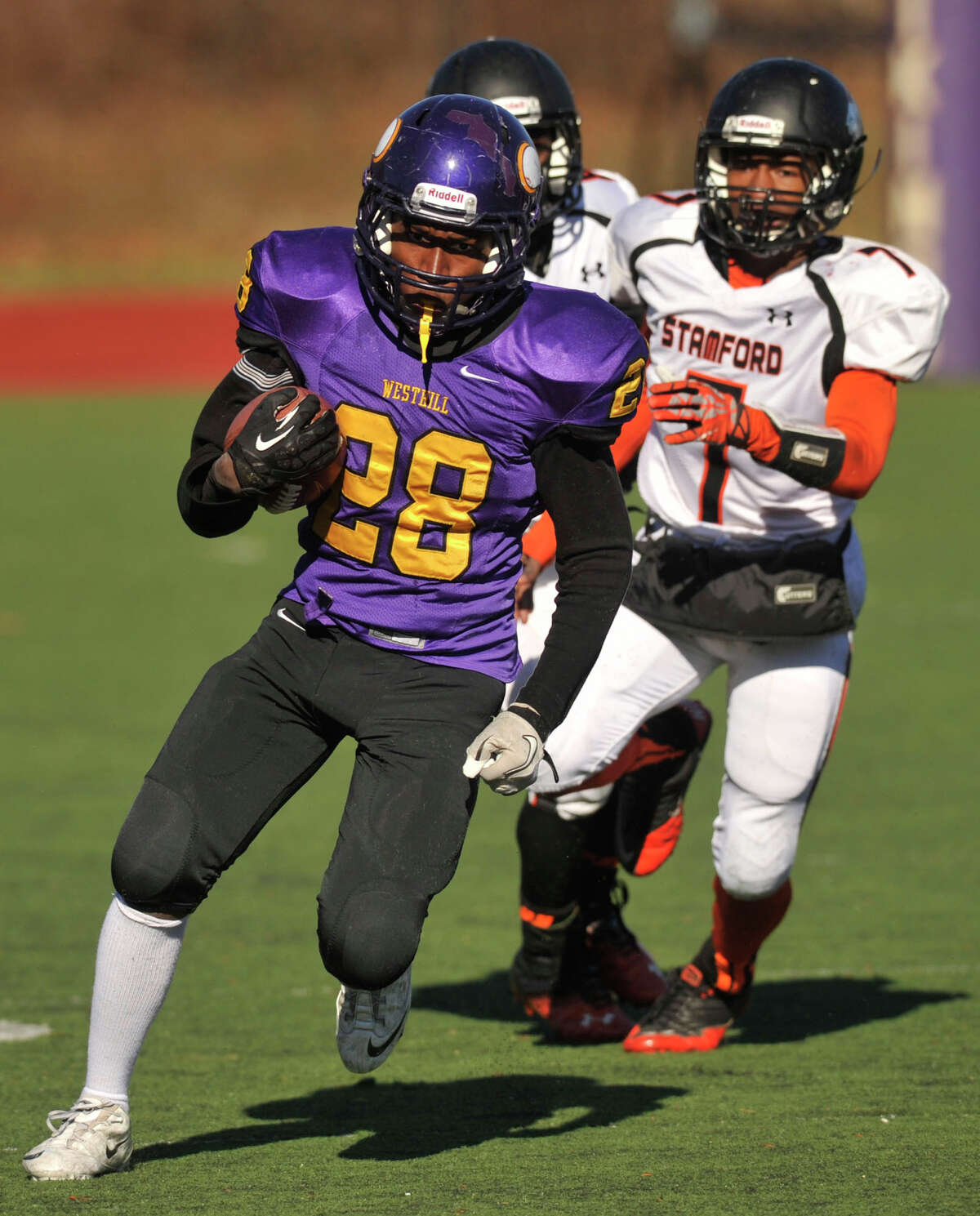 Weshill's Josh Exantus runs with the ball during their game against Stamford at Westhill High School in Stamford, Conn., on Thanksgiving Day, Thursday, Nov. 28, 2013. Westhill beat Stamford, 40-0 to win the City Championship.