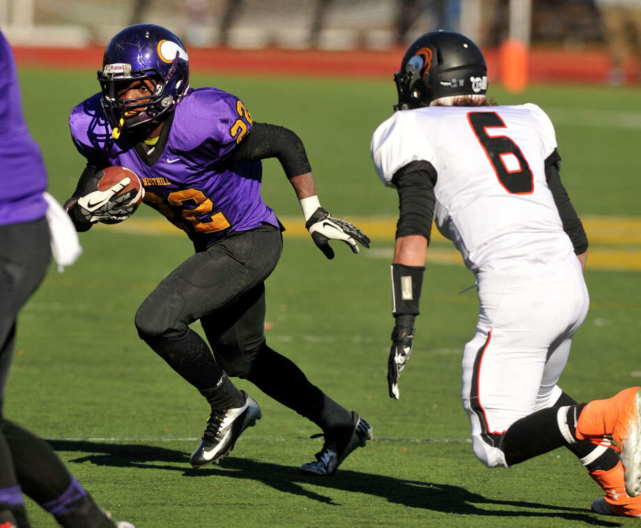 Stamford's Tyler Serricchio tracks down Westhill's Tyreece Mitchell during their game at Westhill High School in Stamford, Conn., on Thanksgiving Day, Thursday, Nov. 28, 2013. Westhill beat Stamford, 40-0 to win the City Championship. Photo: Jason Rearick / Stamford Advocate