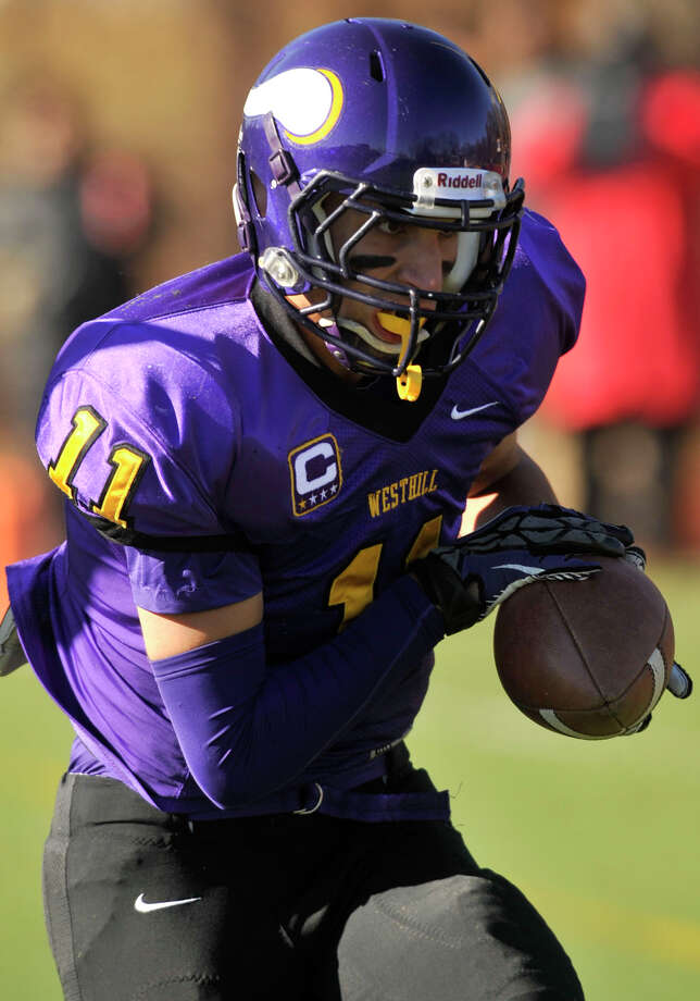 Westhill's Evan Skoparantzos runs with the ball during their game against Stamford at Westhill High School in Stamford, Conn., on Thanksgiving Day, Thursday, Nov. 28, 2013. Westhill beat Stamford, 40-0 to win the City Championship. Photo: Jason Rearick / Stamford Advocate