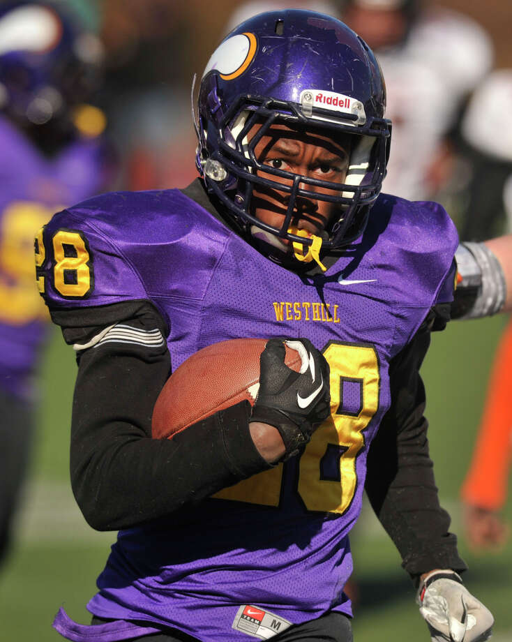 Westhill's Josh Exantus runs with the ball during their game against Stamford at Westhill High School in Stamford, Conn., on Thanksgiving Day, Thursday, Nov. 28, 2013. Westhill beat Stamford, 40-0 to win the City Championship. Photo: Jason Rearick / Stamford Advocate