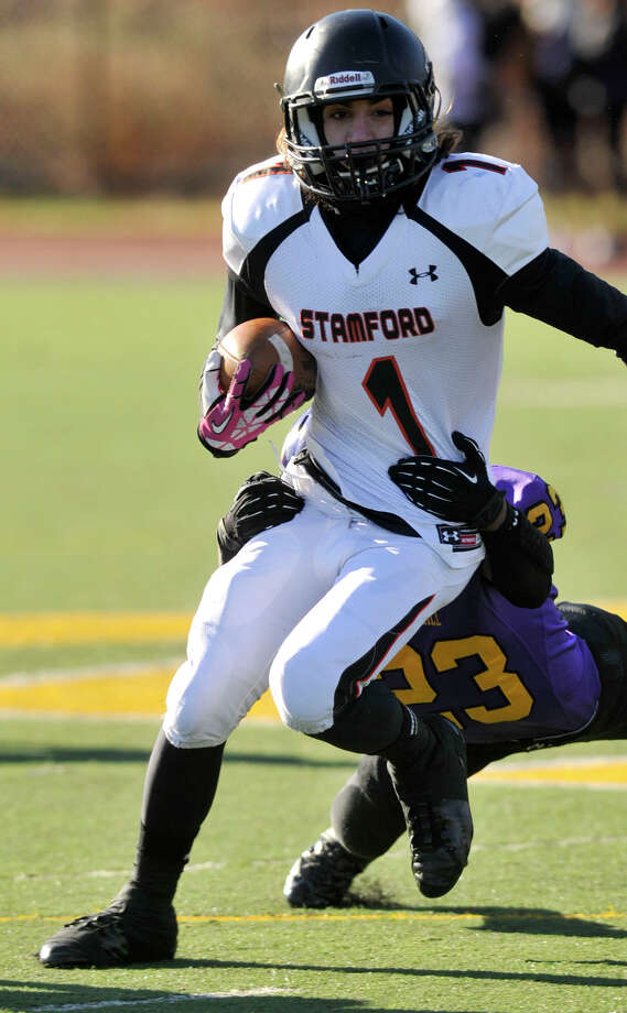 Westhill's Jeff Glover attempts to bring down Stamford's Jake Bivona during their game at Westhill High School in Stamford, Conn., on Thanksgiving Day, Thursday, Nov. 28, 2013. Westhill beat Stamford, 40-0 to win the City Championship. Photo: Jason Rearick / Stamford Advocate