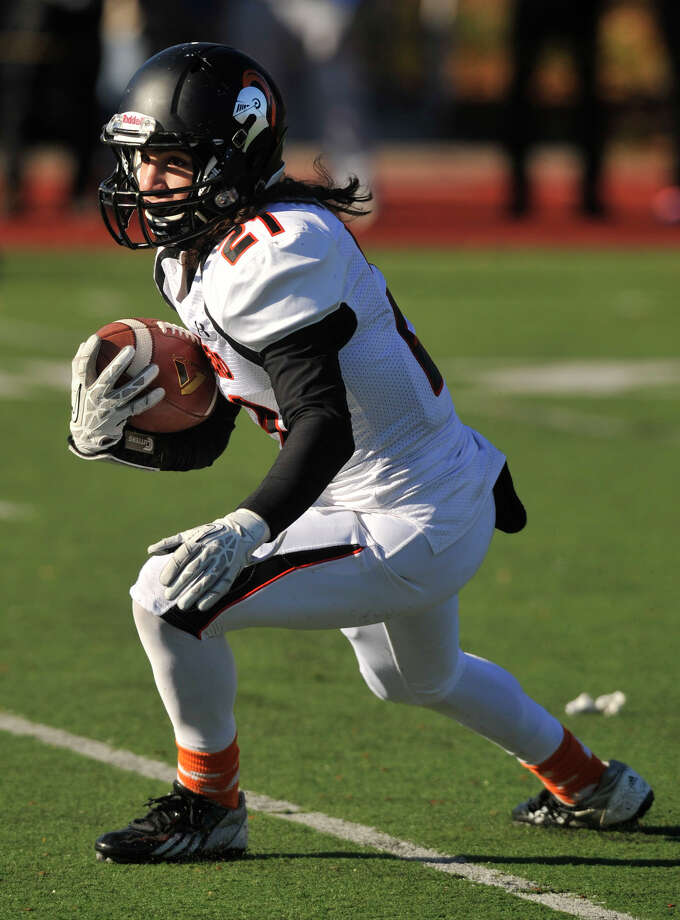 Stamford's Anthony Pearson runs with the ball during their game at Westhill High School in Stamford, Conn., on Thanksgiving Day, Thursday, Nov. 28, 2013. Westhill beat Stamford, 40-0 to win the City Championship. Photo: Jason Rearick / Stamford Advocate