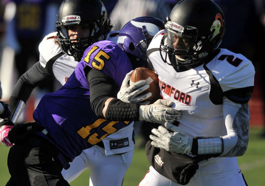 Westhill's Nick Sinatra collides with Stamford quarterback Jalen Brown during their game at Westhill High School in Stamford, Conn., on Thanksgiving Day, Thursday, Nov. 28, 2013. Westhill beat Stamford, 40-0 to win the City Championship. Photo: Jason Rearick / Stamford Advocate