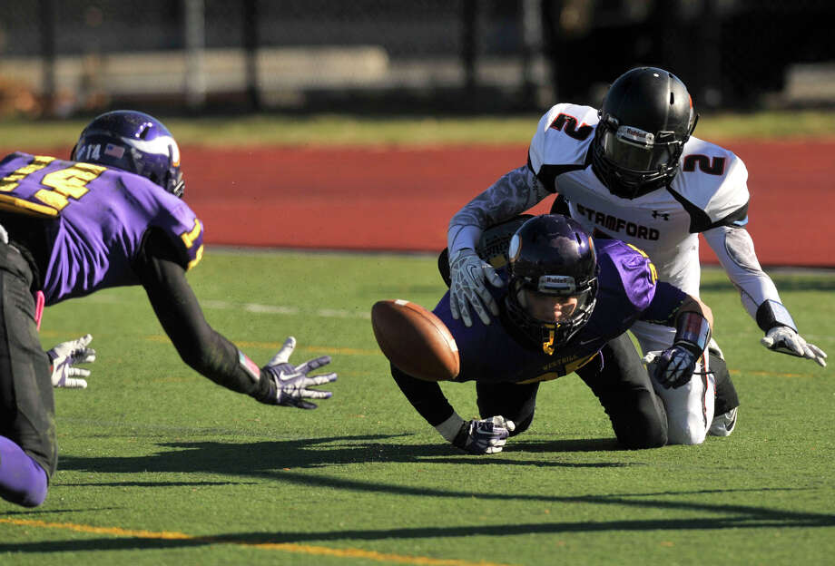 Westhill's Chianta Holtzclaw, left, Zac Cowit and Stamford quarterback Jalen Brown attempt to recover the fumble during their game at Westhill High School in Stamford, Conn., on Thanksgiving Day, Thursday, Nov. 28, 2013. Westhill beat Stamford, 40-0 to win the City Championship. Photo: Jason Rearick / Stamford Advocate