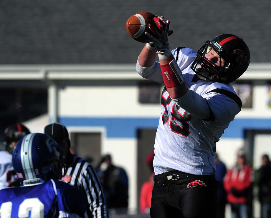 Fairfield Warde's Brian Kerrigan catches the ball in the endzone to score a two point conversion, during Thanksgivig Day football action against cross-town rival Fairfield Ludlowe in Fairfield, Conn. on Thursday November 28, 2013. Photo: Christian Abraham / Connecticut Post