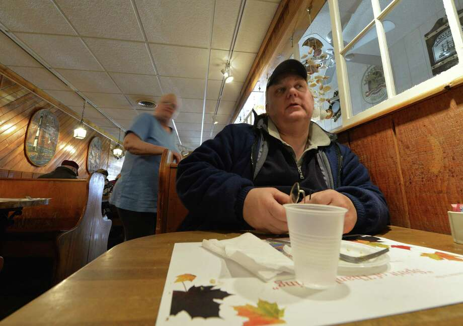 P.W. Klompas speaks to the Times Union about the Thanksgiving dinner he received Thursday afternoon Nov. 28, 2013, at Salty's Pub in Halfmoon, N.Y.      (Skip Dickstein / Times Union) Photo: Skip Dickstein / 00024823A