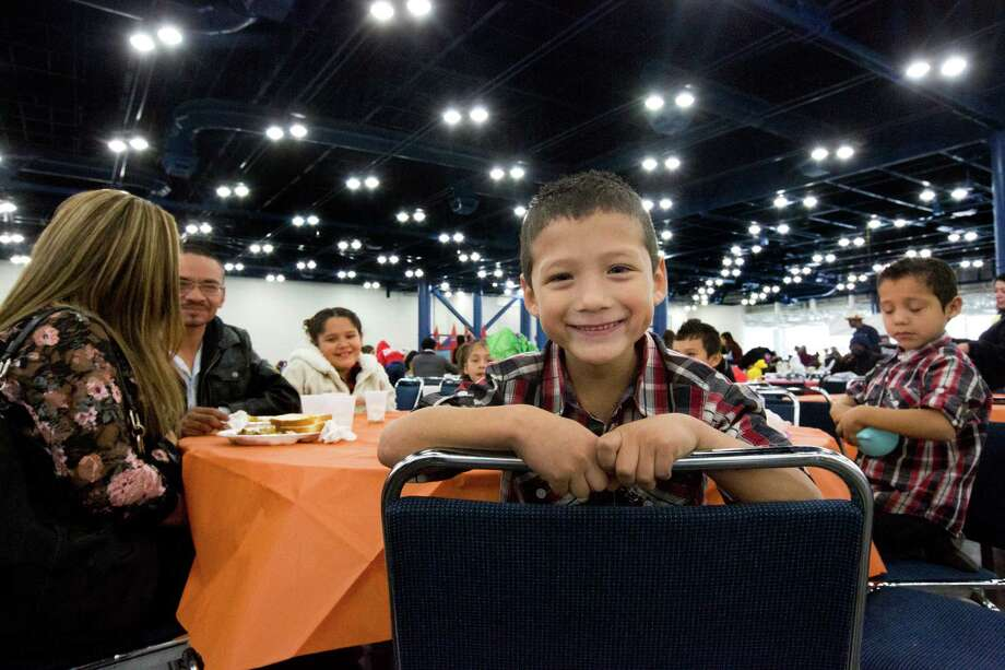 Sixto Roque, 7, came with his family to enjoy of a Thanksgiving Day warm super, Thursday, Nov. 28, 2013, at the George R. Brown Convention Center. About 20,000 guests were welcomed to the 35th Annual Thanksgiving Big Super Feast to receive clothe, groceries and a warm super. Photo: Marie D. De Jesus, Houston Chronicle / © 2013 Houston Chronicle