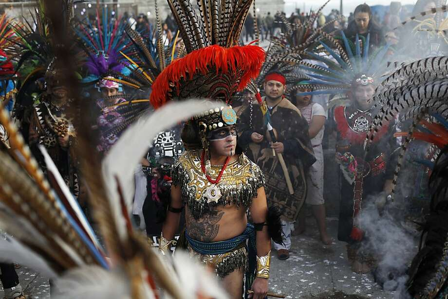 Alvaro Tellez, of Teokalli Aztec Dancers, talks to members of his group after a dance at the Indigenous People's Day Sunrise Gathering on Alcatraz. Photo: Pete Kiehart, The Chronicle