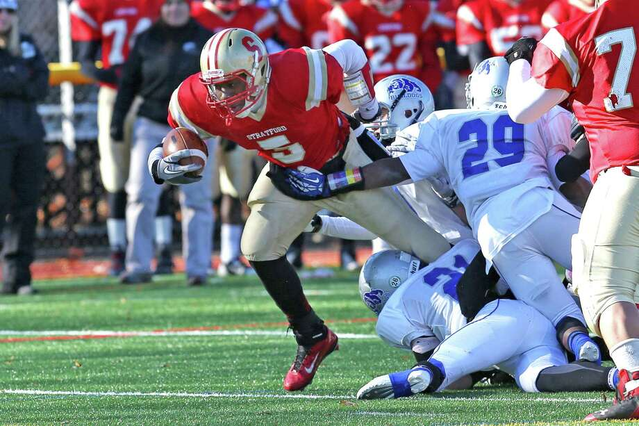 Stratford High School's #5 Gueber Docteur gains extra yardage against Bunnell High School's defense during first half action on Thursday's Thanksgiving match-up.  Bunnell would win 12-10. Photo: Mike Ross / Mike Ross Connecticut Post freelance - @www.mikerossphoto.com