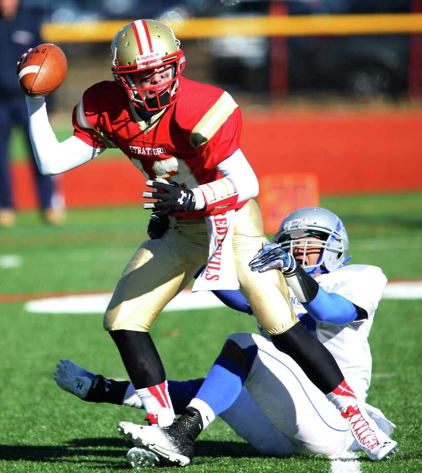 Bunnell High School's #38 (name not on rooster) brings down Stratford High School's #13 quarterback Jack Duffy during Thursday Thanksgiving match-up. Bunnell would win 12-10. Photo: Mike Ross / Mike Ross Connecticut Post freelance - @www.mikerossphoto.com