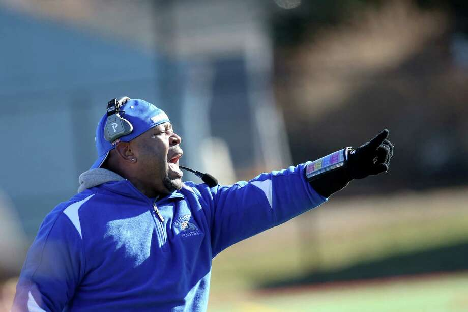 A Bunnell High School coach works the sidelines during Thursday's Thanksgiving match-up against Stratford High School. Bunnell would win 12-10. Photo: Mike Ross / Mike Ross Connecticut Post freelance - @www.mikerossphoto.com