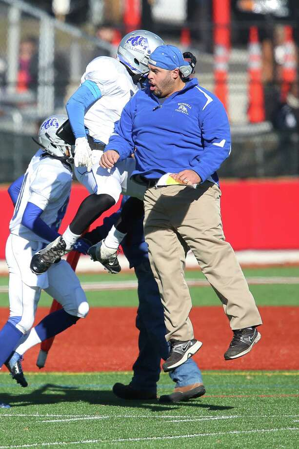 Bunnell High School's head coach Doug Cotto celebrates with his player #25 Zhyaire Fernandes after Fernandes first half touchdown on Thursday Thanksgiving match-up against Stratford High School. Bunnell would win 12-10. Photo: Mike Ross / Mike Ross Connecticut Post freelance - @www.mikerossphoto.com